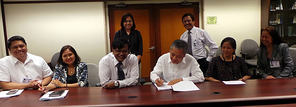 [b]CONTRACT SIGNING. April 21, 2014, ADB Headquarters, Mandaluyong City, Philippines. [/b][br]From left, Mr. Julius Francisco, Vice President of Woodfields Consultants, Inc.;  Ms. Teresita V. Pascual, Managing Director of Ergons Project Marketing Consultant, Dr. Ancha Srinivasan, Principal Climate Change Specialist of ADB, Dr. Gil C. Saguiguit, Jr., Director of SEARCA, Ms. Hiet Tran, Procurement Specialist of ADB, and Ms. Nelfor Atienza, Business Development and Marketing Advisor of CTI Japan. Standing: Ms. Nancy De Leon-Landicho, Program Specialist and Dr. Lope B. Santos III, OIC and Program Specialist both from the Project Development and Management Department (PRODEV) of SEARCA