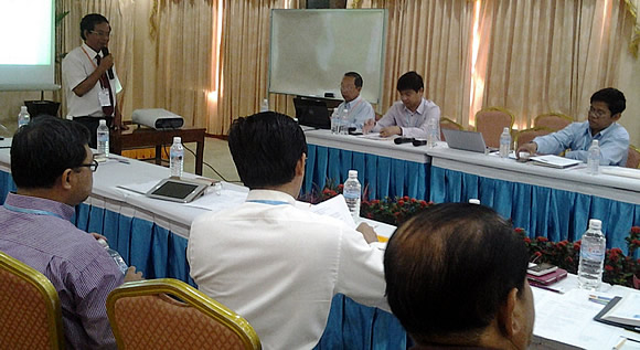 Dr. Men Sarom (standing), SEARCA National Team Leader for Cambodia, providing a presentation on the methodology and selection criteria for good adaptation practices