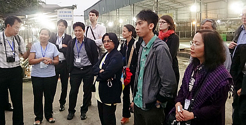 GREASE scientific seminar participants visit Hanoi's swine abattoir after the seminar.