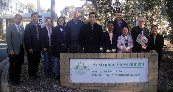 Participants pose for a group photo with ACIAR officials in Canberra, namely: Dr. Mike Nunn, Research Program Manager for Animal Health (fifth from left); Dr. Andrew Alford, Research Program Manager for Impact Assessments (fourth from right); and Dr. Rodd Dyer, Research Program Manager for Agribusiness (second from right).