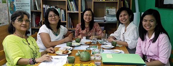 (Left - Right) AFA's Secretary General Ms. Esther Penunia and Policy Advocacy Officer Ms. Maria Elena Rebagay; and SEARCA's Acting Program Head for Research and Development Dr Bessie M. Burgos, Program Specialist Ms. Carmen Nyhria G. Rogel, and ARD2014 Program Associate Ms. Junette Dawn Baculfo