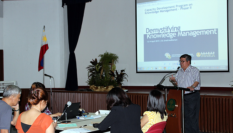 "Dr. Nicomedes P. Eleazar, DA-BAR Director, delivers his message to the participants of the back-to-back training titled [i]""Demystifying Knowledge Management (KM)""[/i]  and [i]""Knowledge Sharing for your Work: Techniques and Tools for Project KM."" [/i]"