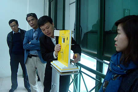 Mr. Dang Duy Hien, (third from left), Director, Bac Hung Hai Irrigation Management Company, demonstrating the use of the Automated Water Level Monitoring System.