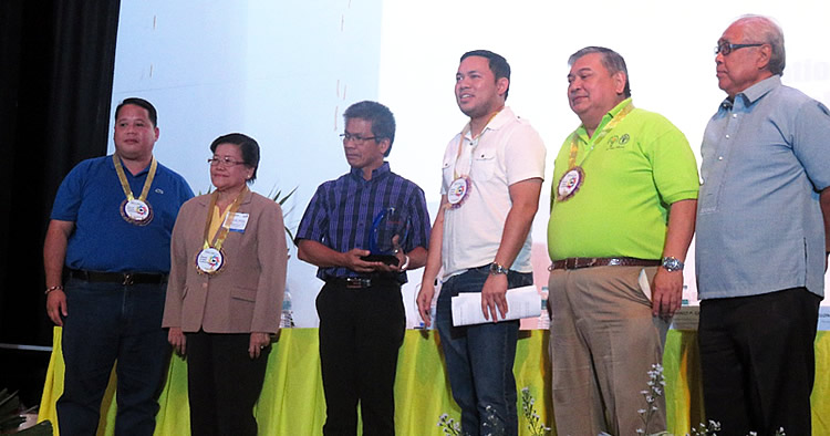 Dr. Flor Lantican with PCC Acting Executive Director Dr. Arnel del Barrio and Conference guests of honor.