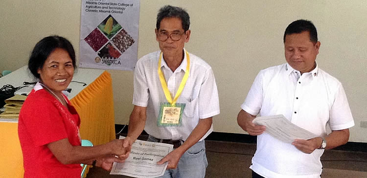 A participant receives her certificate from Dr. Arsenio D. Calub, Project Leader, and Dr. Rosalito A. Quirino, MOSCAT President.
