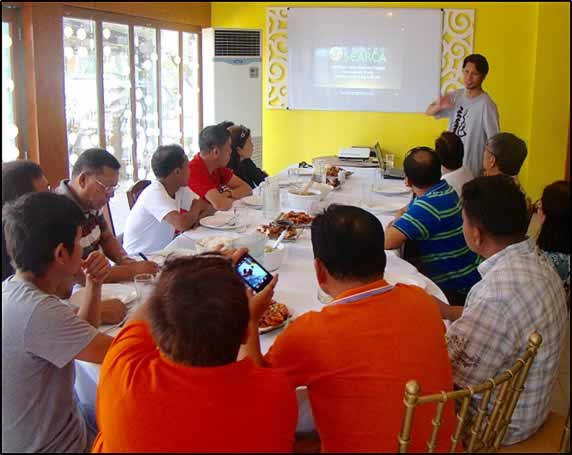 SEARCA Research Specialist, Henry M. Custodio, discussing the  elements of SEARCA's inclusive and sustainable agricultural and  rural development model and thrusts to local government officials  of Sablayan in Occidental Mindoro.