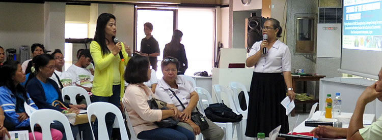 A representative from Cabulisan Women's Association asks questions about vegetable production.