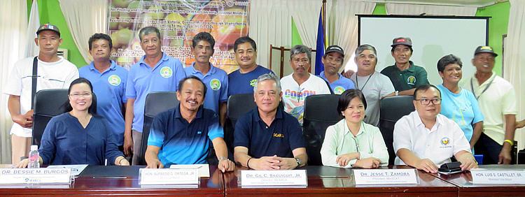 L-R: Dr. Bessie M. Burgos (SEARCA), Mayor Alfredo G. Ortega, Jr. (LGU), Dr. Gil C. Saguiguit, Jr. (SEARCA), Dr. Ma. Concepcion L. Mores (MinSCAT), Vice Mayor Luis S. Castillet, Sr. with the Upland Farmers Association