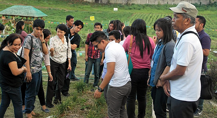 The participants visit the Bureau of Plant Industry's (BPI) Organic Demo Farm for Organic Seed Production.