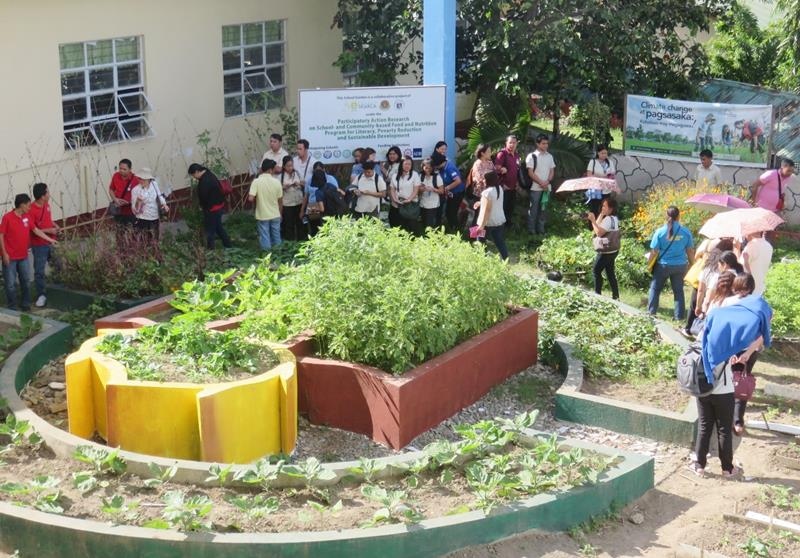 Participants touring the SEARCA-DepEd-UPLB School Garden of Pedro Guevara Memorial National High School