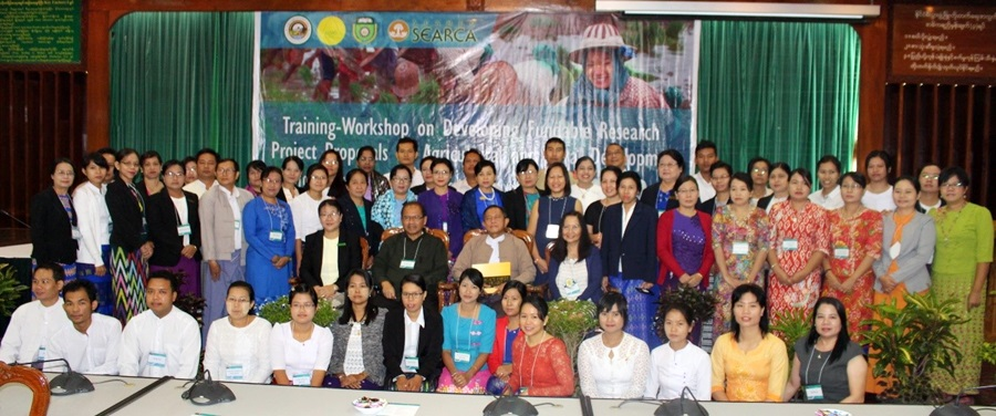 48 HEI and MoALI participants pose with Dr. Tin Htut, Permanent Secretary, MoALI (seated, 3rd from left); Dr. Maria Celeste H. Cadiz of SEARCA (seated beside him); and workshop organizers and resource persons.