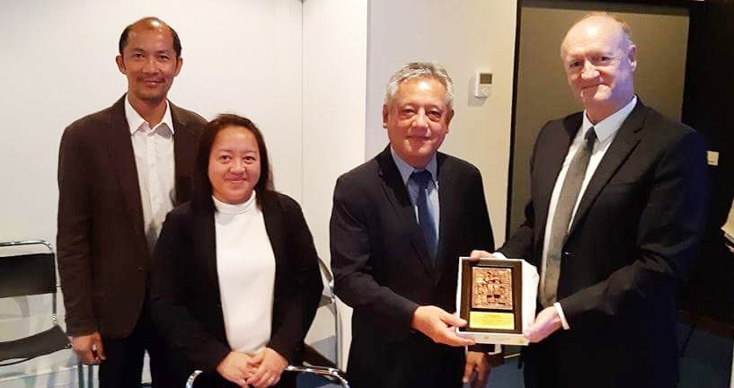 Dr. Saguiguit presents to Dr. Kosuth as institutional gift a replica of SEARCA's growth monument. They were joined by Mr. Oliver Oliveros (leftmost), Deputy Director for Partnerships and International Cooperation of Agropolis Fondation.