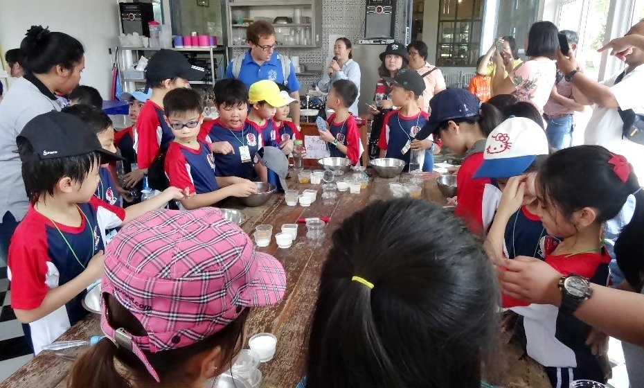 Participants watch students from an international school in Thailand undergo workshop on ice cream making using buffalo milk at the Mini Murrah Farm in Chachoengsao Province.