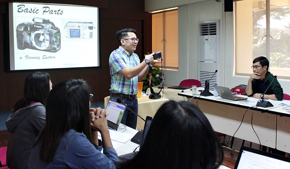 Asst. Prof. Edmund Centeno (standing), mentor for Photography and Audio-Visual Writing and Production, shows the basic parts of a camera.