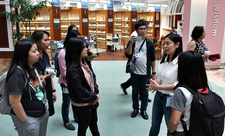 The learner-participants get a glimpse of ADB's modern library during their study tour.