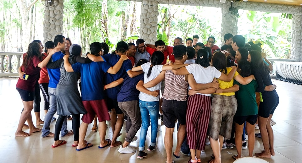 We are a family. SEARCA scholars' group hug before going back to Los Banos.