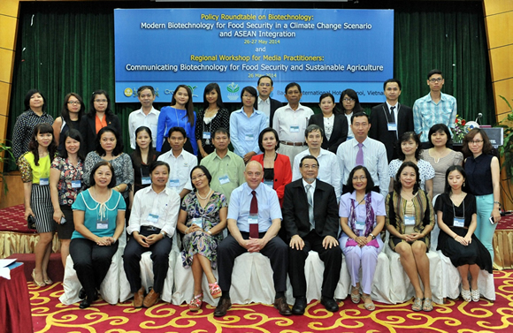 Participants, resource persons, and organizers of the Eleventh Policy Roundtable on Building Capacities for Agricultural Competitiveness in Transition Southeast Asia and Regional Workshop for Media Practitioners. [br] (Photo courtesy of HNTV)