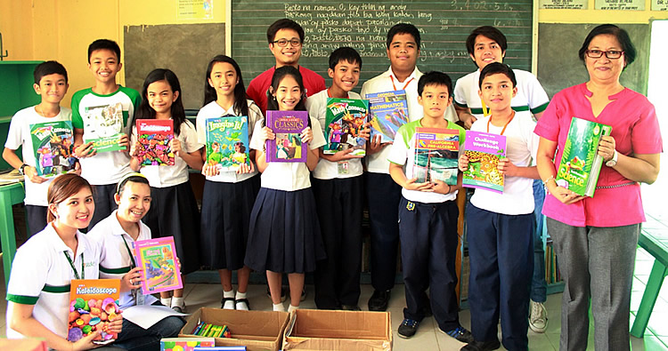 Elementary students receive science, mathematics, and language textbooks and reference materials from SEARCA.