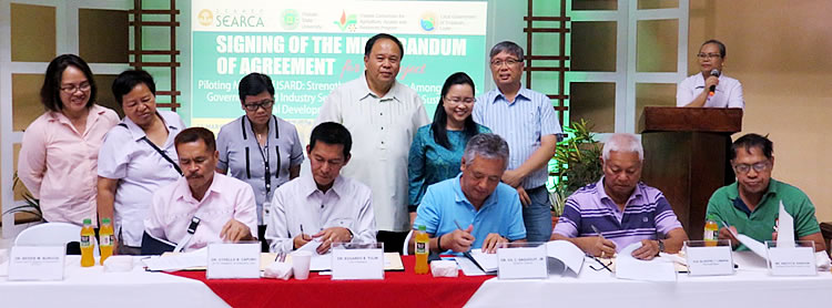 (Front L-R) Dr. Othello Capuno, Dr. Edgardo Tulin, Dr. Gil C. Saguiguit, Jr., Hon. Silvestre Lumarda, Mr. Anecito Asencion – while signing the MOA. (Back L-R) Mrs. Rebecca Macabenta-Cormanes, Dr. Wolfreda T. Alesna, Dr. Vilma Patindol, Dr. Jose Bacusmo, Dr. Bessie Burgos and Prof. Rolando Bello acts as witnesses.