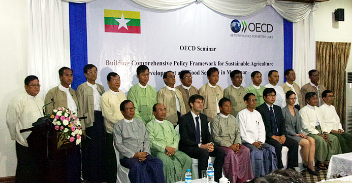 The new Union Minister of MOALI, H.E. Dr. Aung Thu (5th from left first row) and the Deputy Minister Dr. Tun Winn (4th from left first row) were joined by OECD Officers and other high Officials of MOALI led by the Permanent Secretary Dr. Tin Htut (2nd from right first row) as well as Mr. Tin Htut Oo, Chair of NESAC (1st from left first row) and YAU Rector Dr. Myo Kyew (3rd from left second row).