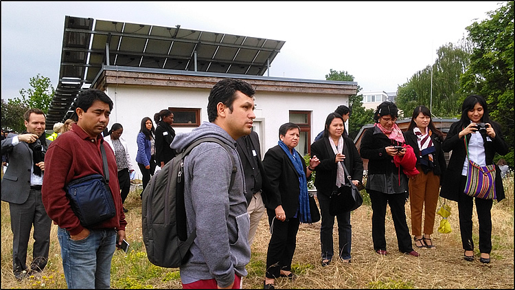 DELEGATES AT THE GREEN ROOF. The delegates of the International EbA Community of Practice Workshop visit an EbA best practice with the green roof, solar panel and water harvesting facility. This system is practiced in other communities in Germany including high end property urban development.