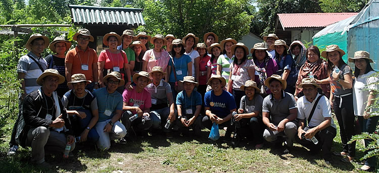 Participants at the crop museum of IIRR, Silang, Cavite with Ms. Irish Baguilat