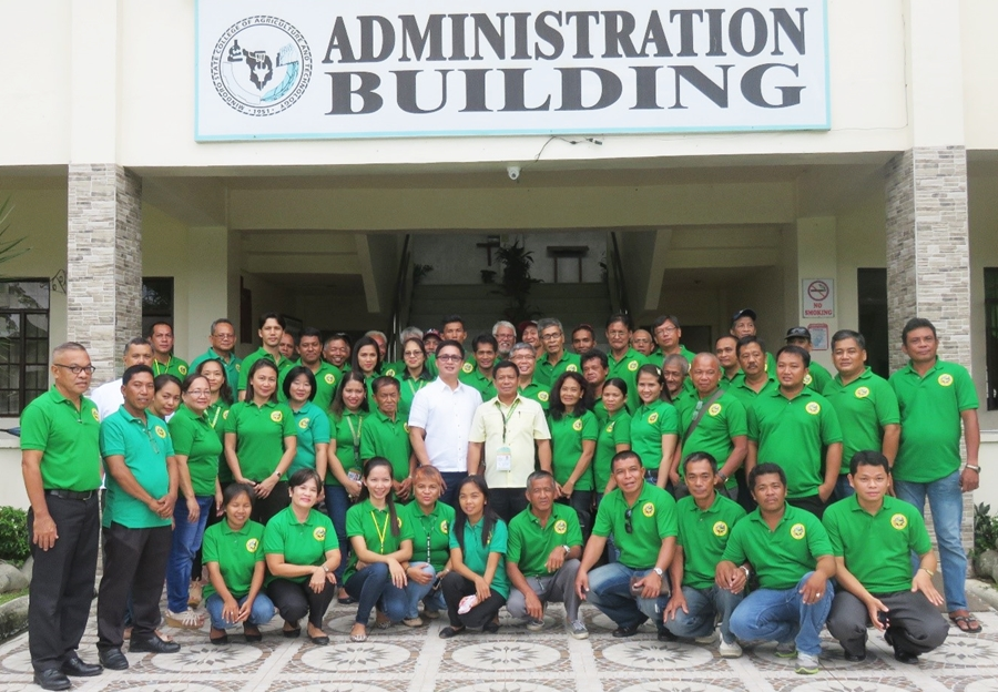 Calamansi growers with the MinsCAT, LGU Victoria and SEARCA ISARD Teams