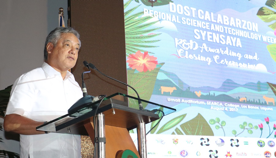 Dr. Gil C. Saguiguit, Jr., SEARCA Director, welcomes the guests to the SyenSaya R&D Awarding and Closing Ceremonies.