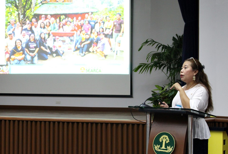 Ms. Gigi Pontejos-Morris, Owner of MoCA Family Farm RLearning Center in Padre Garcia, Batangas, updates participants on practices and challenges of farm tourism in the Philippines, showing a photo of dedicated farm tourism pioneers when they first banded together to advance their cause.