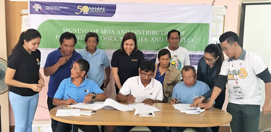 Seated (L-R): Mr. Victoriano Petina, Jr., President of RDPA; Mr. Rolly C. Mateo, Chairman, BSNMPC; and Mr. Romeo S. Doton, Chairman, PPMPC. | Standing (L-R): Ms. Sarah Quiñones, SEARCA Project Coordinator; Mr. Reynaldo D. Paneda; Science Research Analyst/AI Coordinator of PCC at DMMMSU; Mr. Ricardo C. Eblogan, Sr., Vice President, RDPA; Ms. Nancy Landicho, SEARCA Program Specialist; Dir. Gloria M. dela Cruz, PCC Center Director at DMMMSU; and Mr. Nicasio E. Olipas, Jr., Vice Chairman of PPMPC.