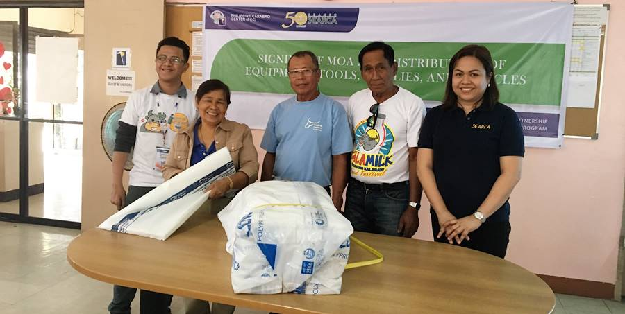 L-R: Mr. Zadieshar Sanchez, Administrative Officer V, PCC National Headquarters; Dir. Gloria Dela Cruz, PCC Center Director at DMMMSU; Mr. Romeo S. Doton, Chairman; Mr. Nicasio E. Olipas, Jr., Vice Chairman of PPMPC; and Ms. Nancy Landicho, SEARCA Program Specialist during the awarding of supplies of 2,000 pieces of plastic bags for their forage silage.