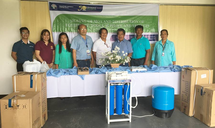 L-R: Mr. Zadieshar Sanchez, Administrative Officer V, PCC OED; Ms. Nancy Landicho, SEARCA Program Specialist; Ms. Lolita Aganon, Book Keeper, CAVAFEDCO; Dr. Franklin Rellin, Center Director, PCC CSU; Mr. Nestor Bautista, Chairman, CAVAFEDCO; Mr. Gilbert Benigno, Chairman, SADACO; Mr. Juan Agabin, Manager, IFC; and Ms. Edelina Rellin, Senior Science Research Specialist, PCC CSU during the distribution of water distillers to CBED cooperatives
