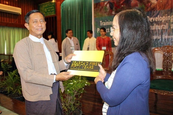 Dr. Tin Htut receives the coffee table book SEARCA's First Fifty Years from Dr. Cadiz.