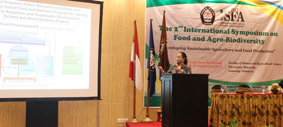 Dr. Burgos presenting the paper titled 'Building ISARD with Agrobiodiversity: Towards Food Security and Community Livelihoods'.