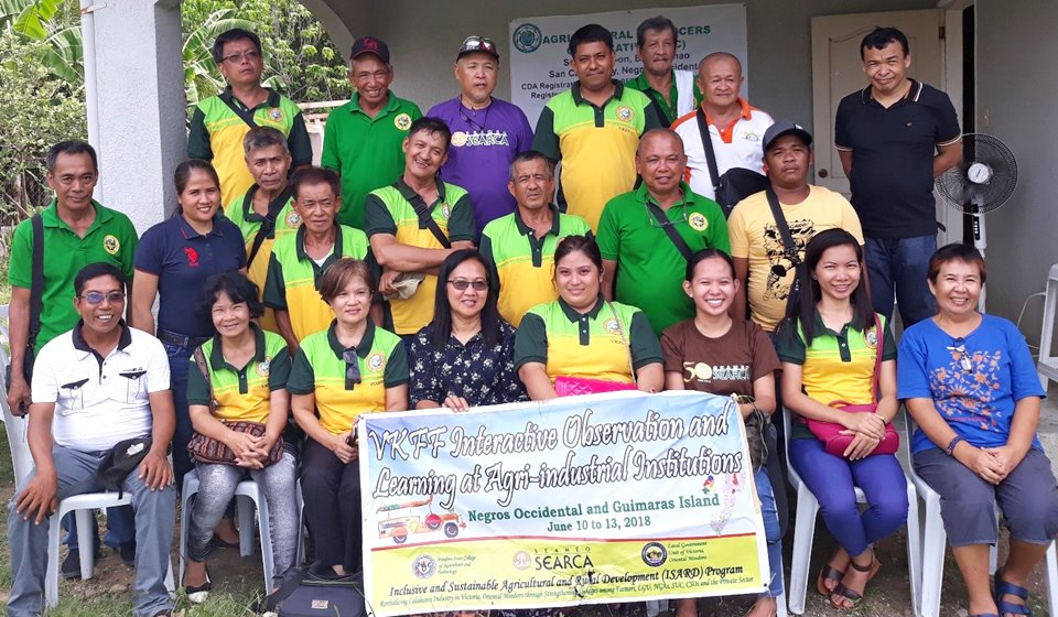 Participating members of the VKFF, LGU, MinSCAT and ISARD Pilot Program Team with Mr. Danny Moraca, Multi-Sectoral Alliance for Development Negros (MUAD-Negros) Organizational Development Coordinator (far right – 3rd row) and Ms. Gilda Parreño Agricultural Producers Cooperative (APC) Manager (far right – first row)