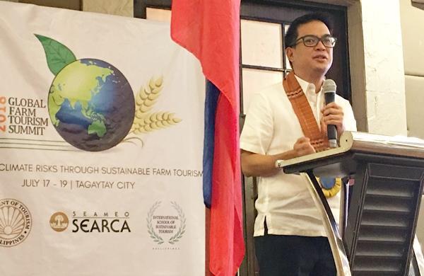 Tourism Assistant Secretary Roberto Alabado III delivers the keynote message on behalf of Philippine Tourism Secretary Bernadette Romulo-Puyat.