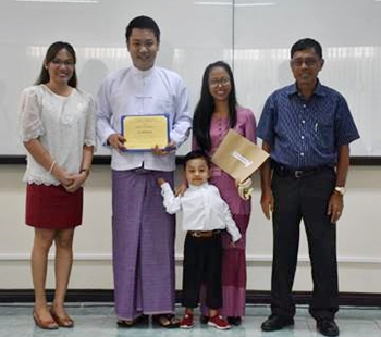 Speech Prof. Kristine Adalla (left) and CAS Dean and LITE Manager Dr. Felino Lansigan (right-most) handed the certificates to  Mr. Zaw Win Kyaw as he received his certificate, with his wife and three-year old son (center).